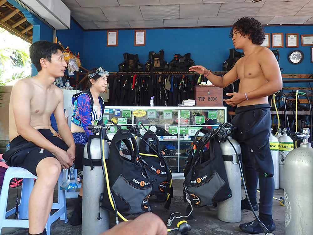 Divers receive a pre-dive instructional briefing in Tulamben Bali