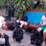 Prepping BCDs during PADI Open Water Diving Course in Tulamben, Bali, Indonesia
