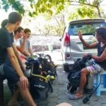 Teaching beginner divers how to use diving hand signals in Tulamben, Bali, Indonesia