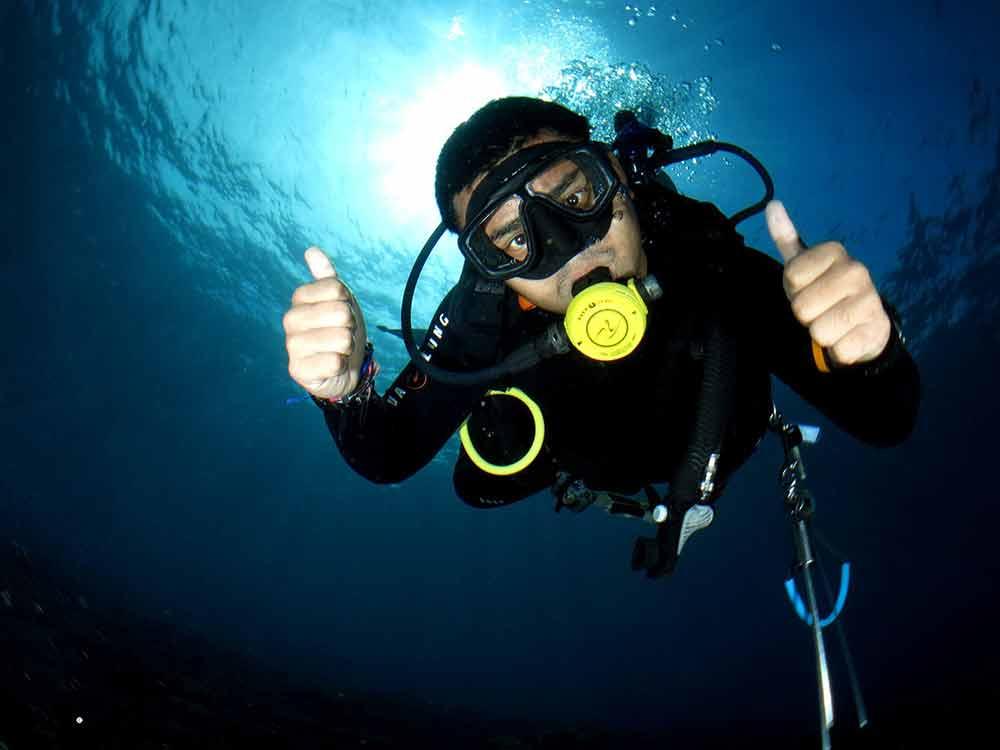 Scuba Diver having fun diving in Tulamben, Bali, Indonesia
